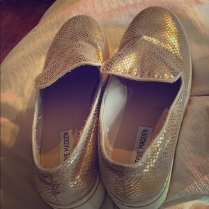 Gold snake skin sneakers with wedge